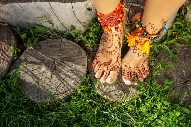 Beautiful legs with accessories and mehendi stock photo