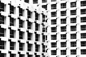 beautiful light and shadow on windows and building balconies of the vintage hotel in the summertime. black and white photo of architecture design.