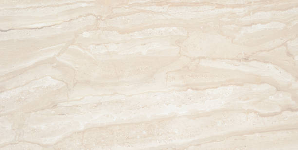 Beautiful light bege marble. Natural high detail marble with amazing natural pattern. stock photo