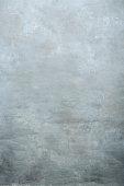 istock Beautiful  light  grey textured backdrop studio wall 1287431137