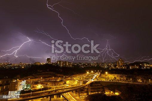 1140941490 istock photo beautiful lightning in the night sky 494913874