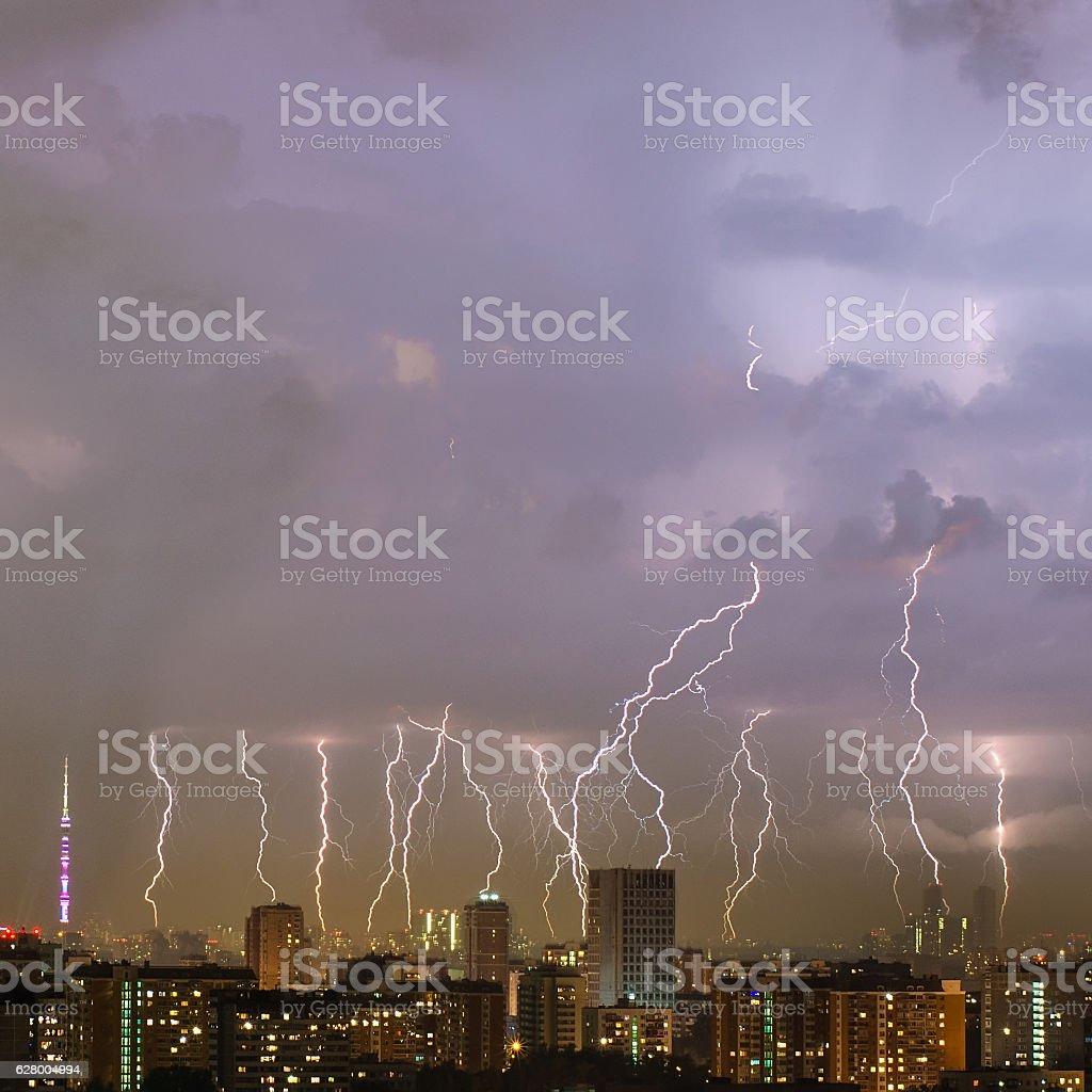 Beautiful lightning strike over big city. - fotografia de stock