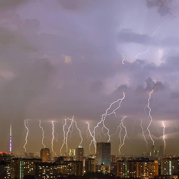 beautiful lightning strike over big city. - greve imagens e fotografias de stock