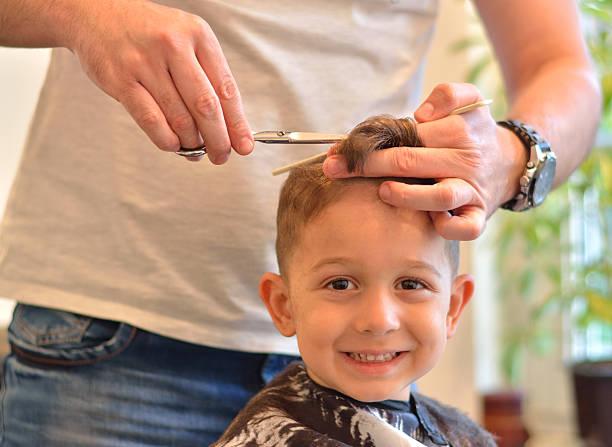Beautiful Litlle Boy Getting A Haircut Stock Photo