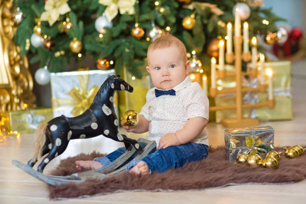 Beautiful little baby boy celebrates christmas new years holidays in picture id883687102?b=1&k=6&m=883687102&s=612x612&w=0&h=yexhh1fx1a1hab9rncjzo80oekil5vb1g lm296smaw=