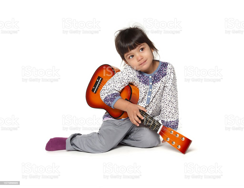 beautiful little baby girl playing guitar royalty-free stock photo