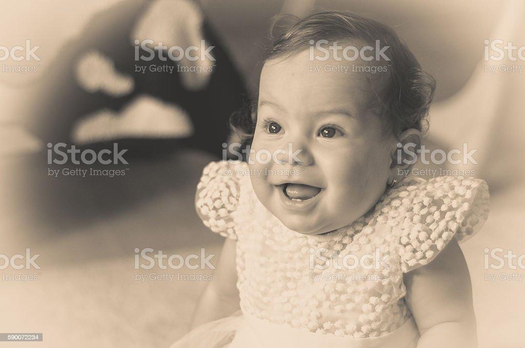 beautiful little baby one year sitting on a carpet - foto de acervo