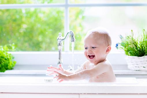 Beautiful little baby taking bath