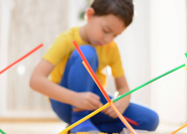 Beautiful little boy is playing with creative educational toys stock photo