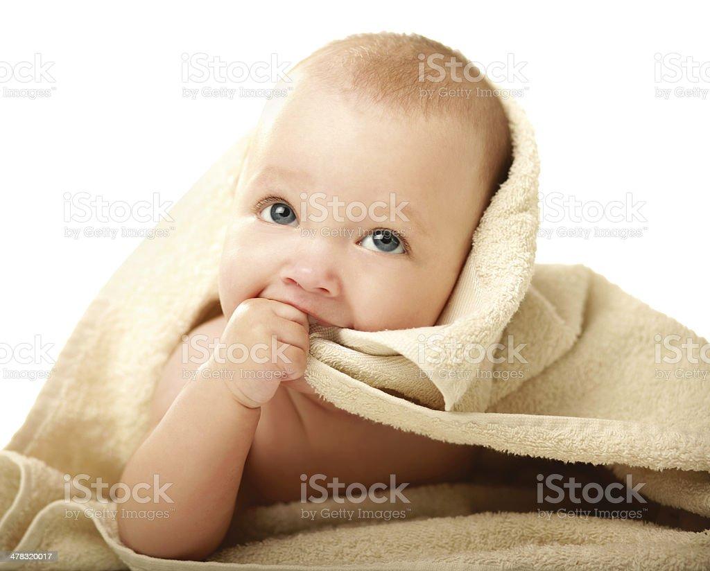 beautiful little boy lying on beige towel royalty-free stock photo