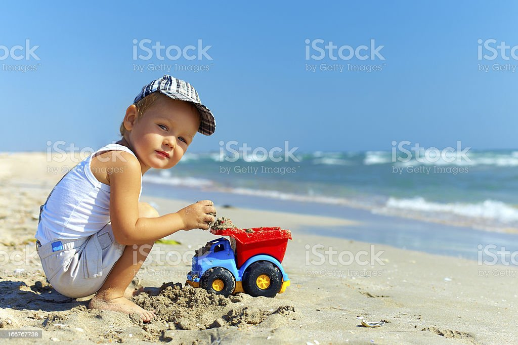 beautiful little boy playing on the beach royalty-free stock photo