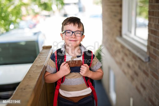 istock Beautiful little boy with backpack ready back to school 854631946