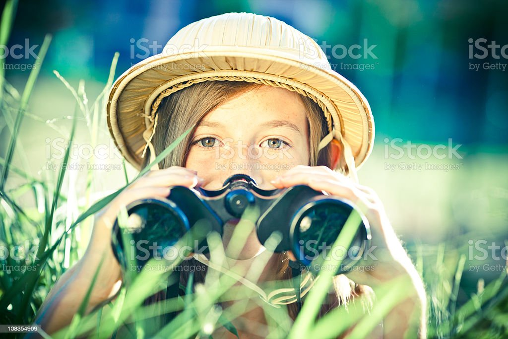 beautiful little explorer girl with binoculars at park royalty-free stock photo