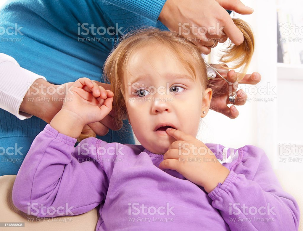 Beautiful little girl at the hairdresser royalty-free stock photo
