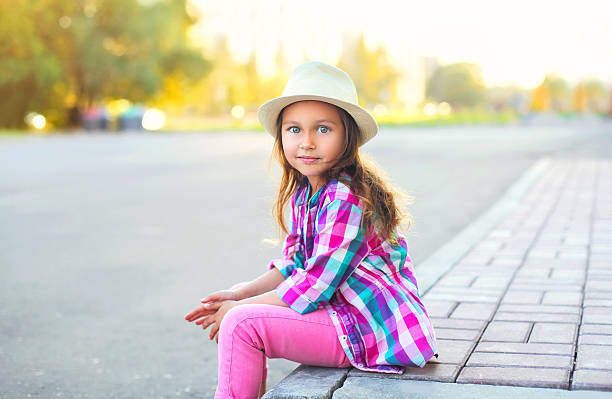 beautiful little girl child wearing shirt and hat in city - tween models stock photos and pictures