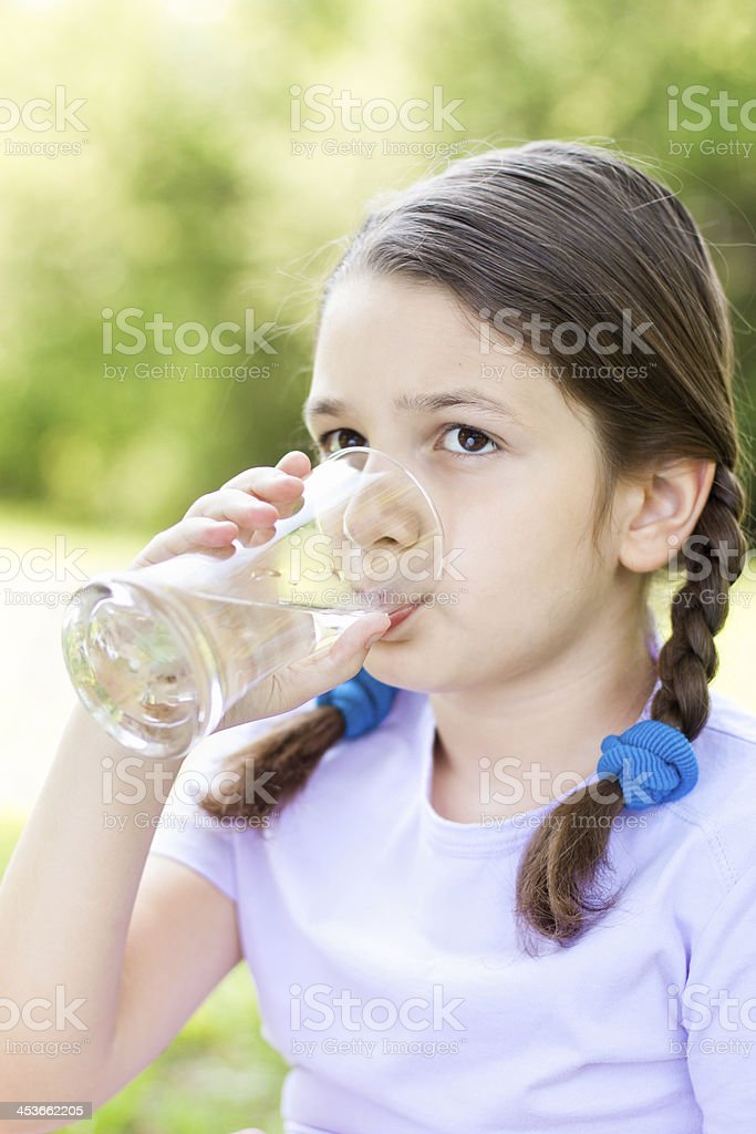 Beautiful Little girl drinking water royalty-free stock photo