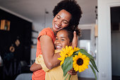 istock Beautiful little girl giving her mother a mother's day present 1224703944