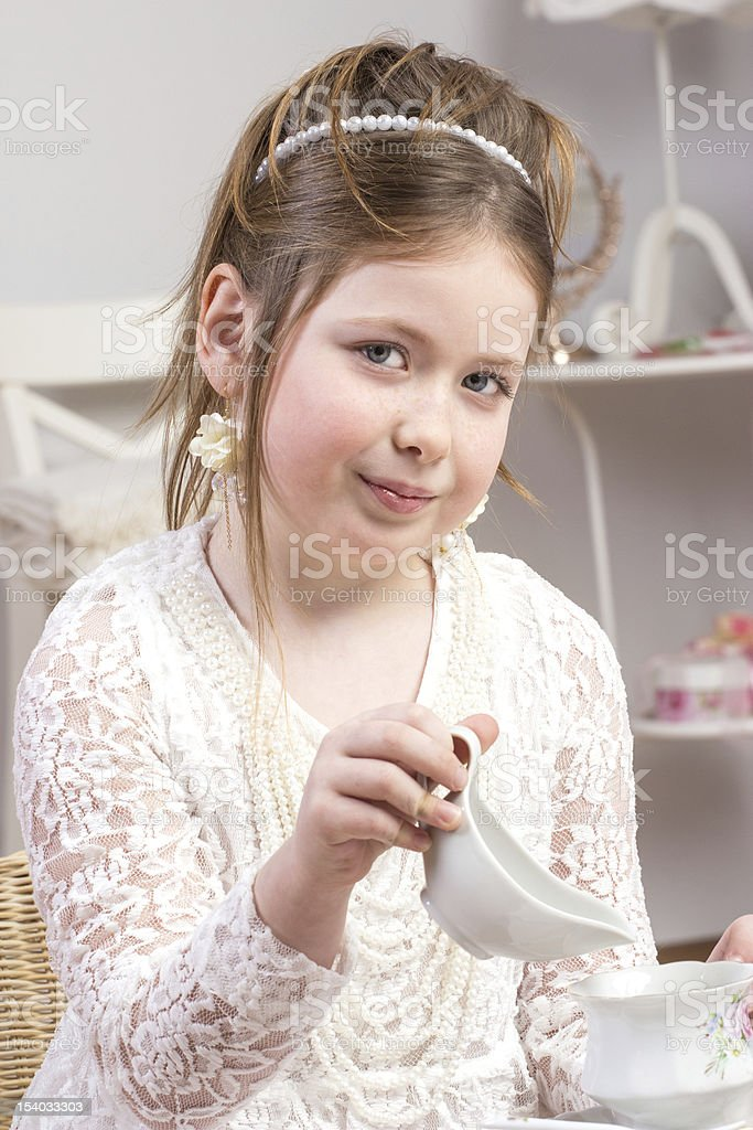 beautiful little girl having a tea party royalty-free stock photo