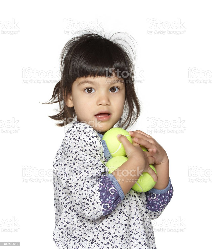 beautiful little girl holding tennis balls royalty-free stock photo