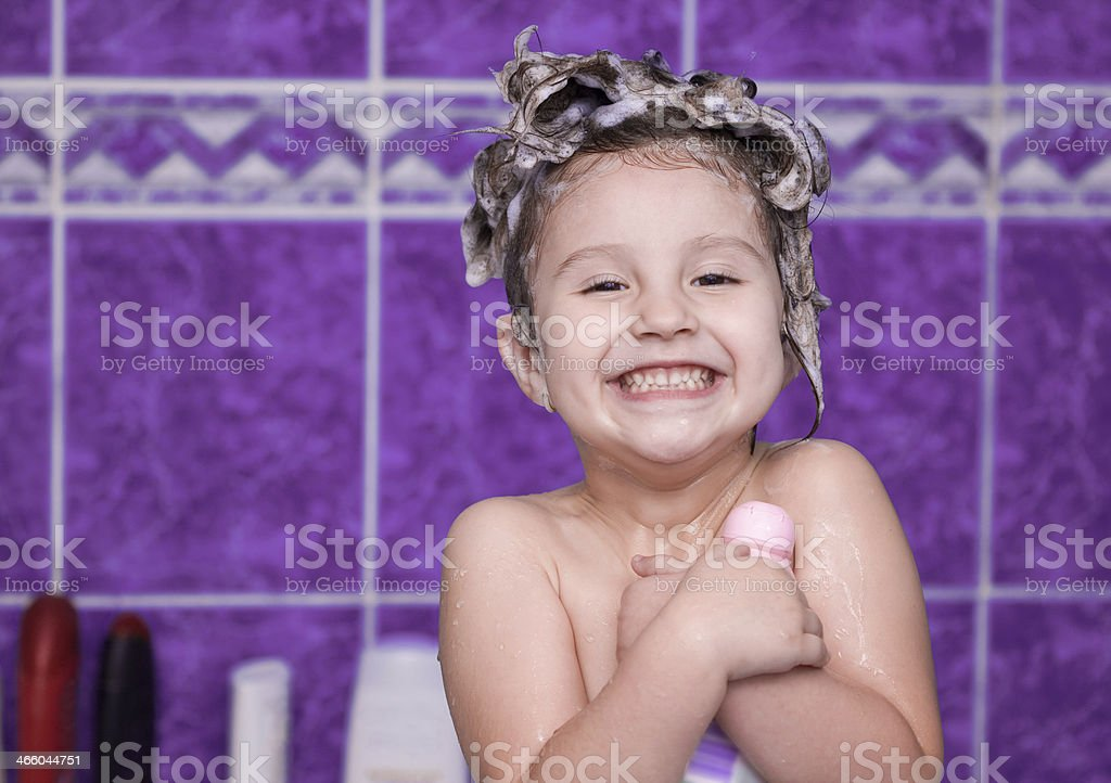 Beautiful little girl in bathroom royalty-free stock photo