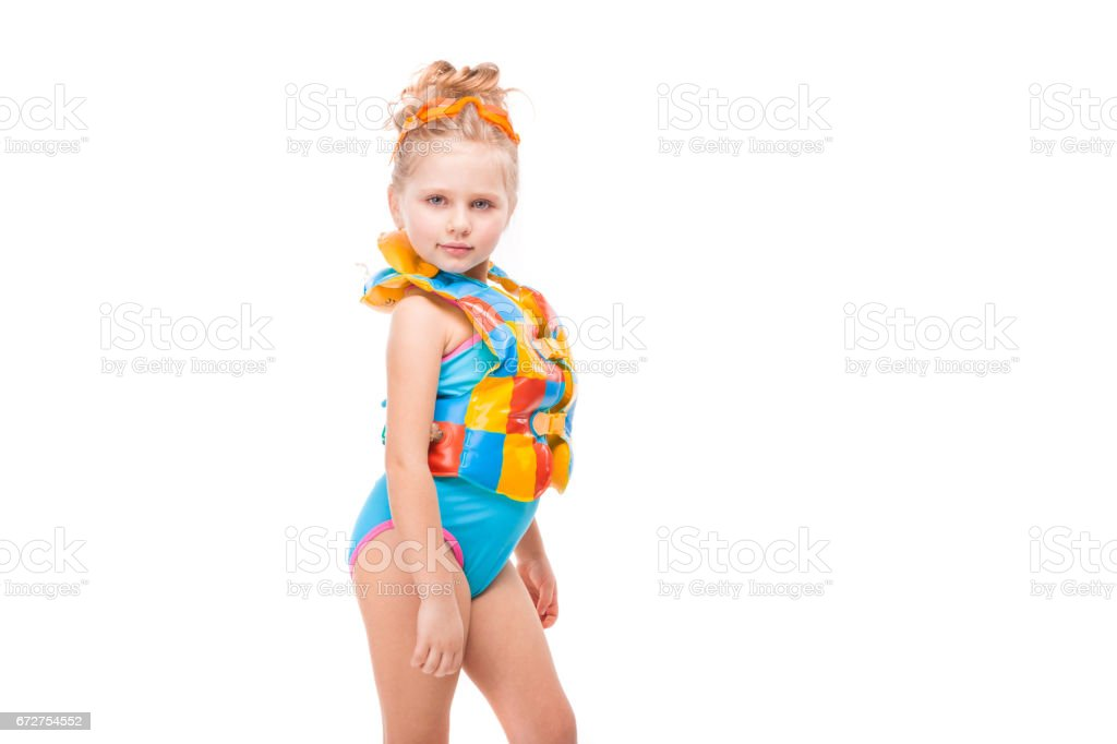 f45a21b23682e Beautiful little girl in in blue swimming suit and colorful life jacket -  Stock image .