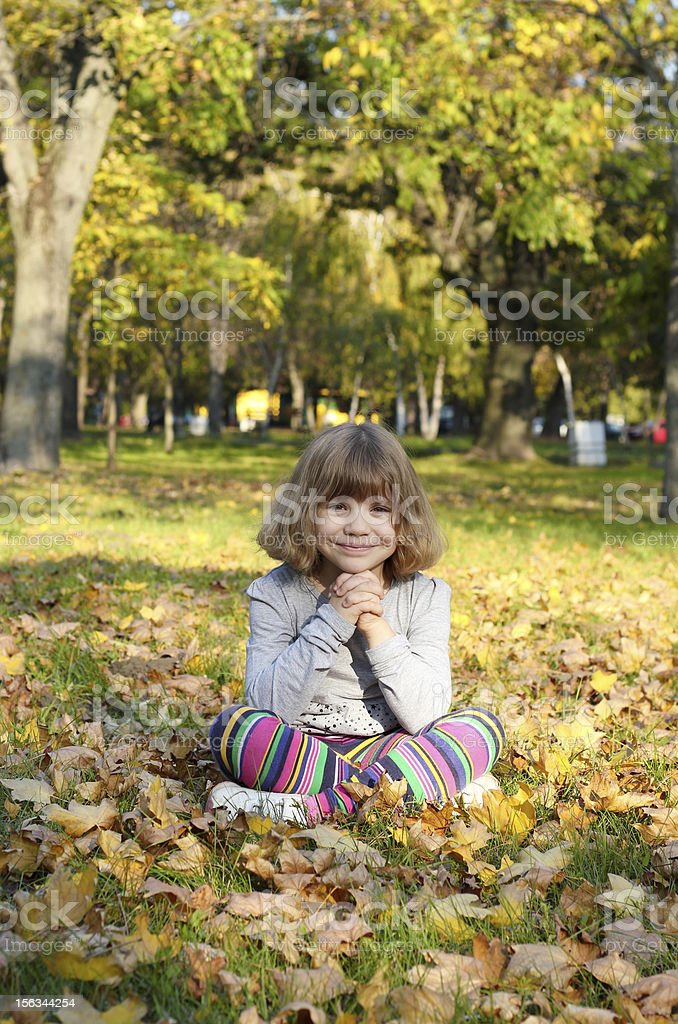 beautiful little girl in park royalty-free stock photo