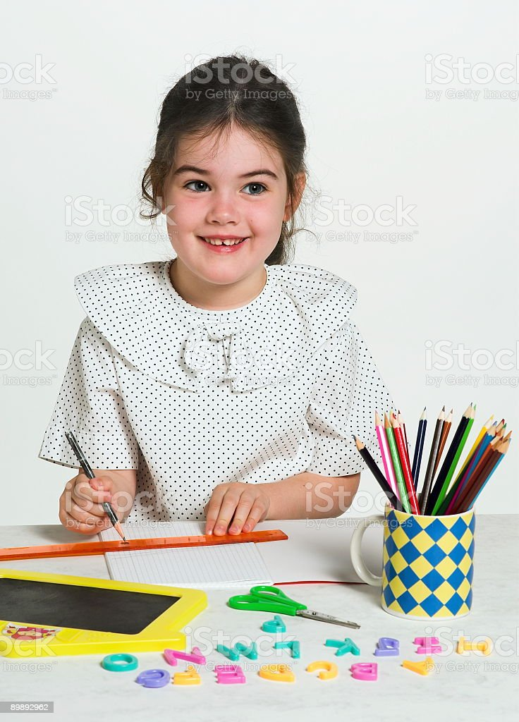 Beautiful little girl learning royalty-free stock photo