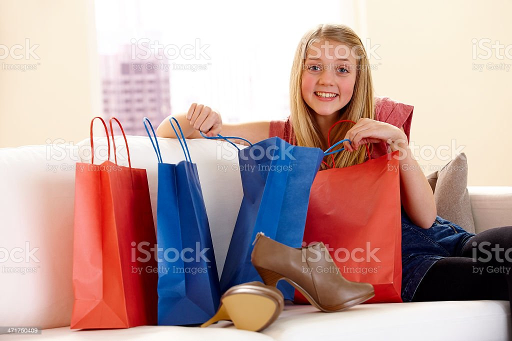 Beautiful little girl opening purchase after shopping royalty-free stock photo