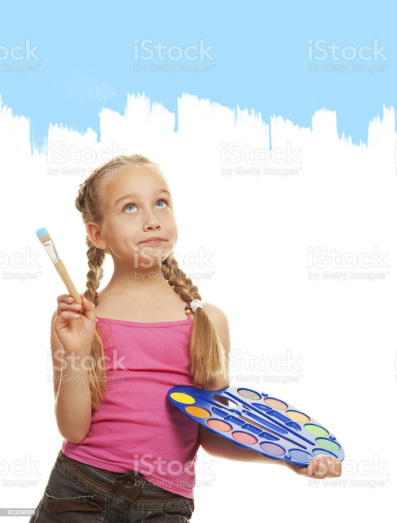 Beautiful little girl painting with blue paint royalty-free stock photo