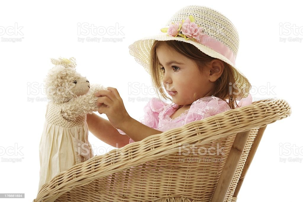 beautiful little girl playin with her bear royalty-free stock photo