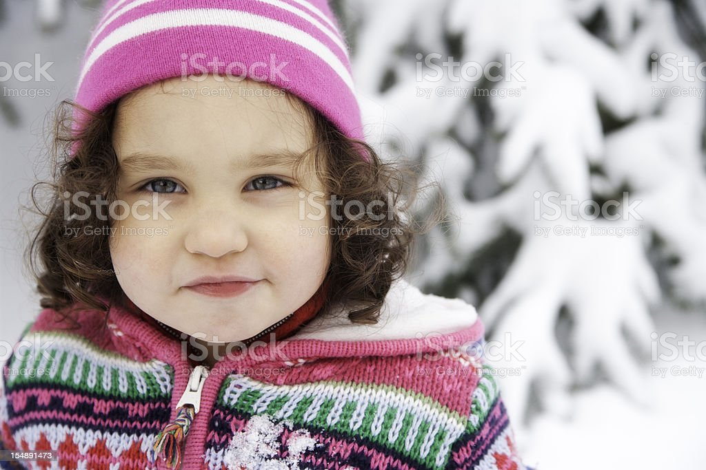 Beautiful Little Girl Playing in the Snow royalty-free stock photo