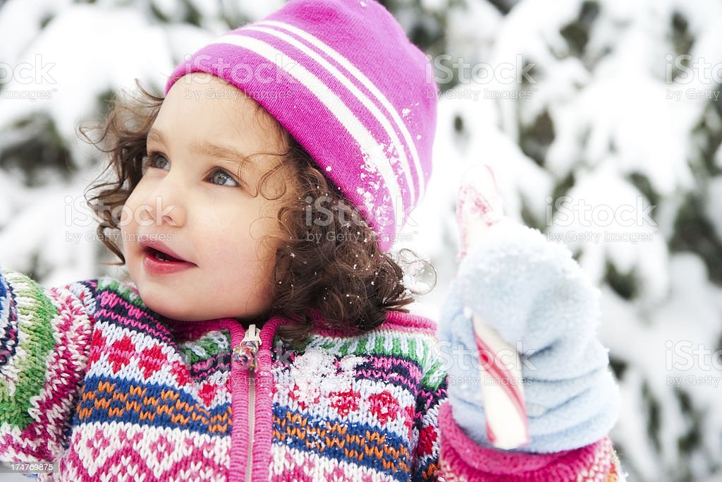 Beautiful Little Girl Playing in the Snow Wearing Pink Hat royalty-free stock photo