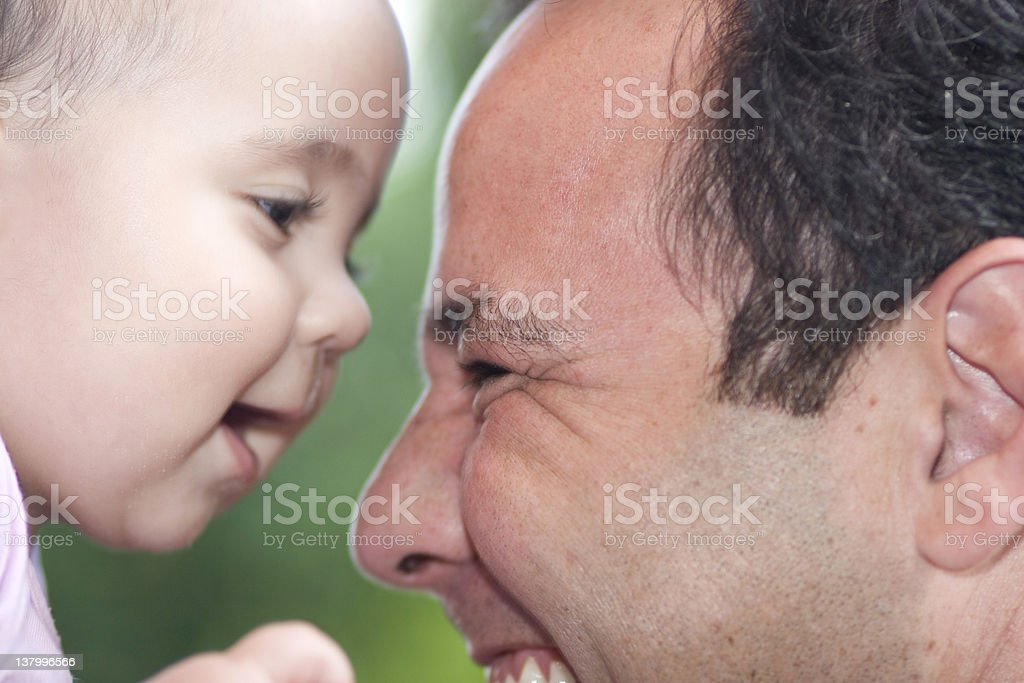 Beautiful Little Girl Playing With Dad royalty-free stock photo