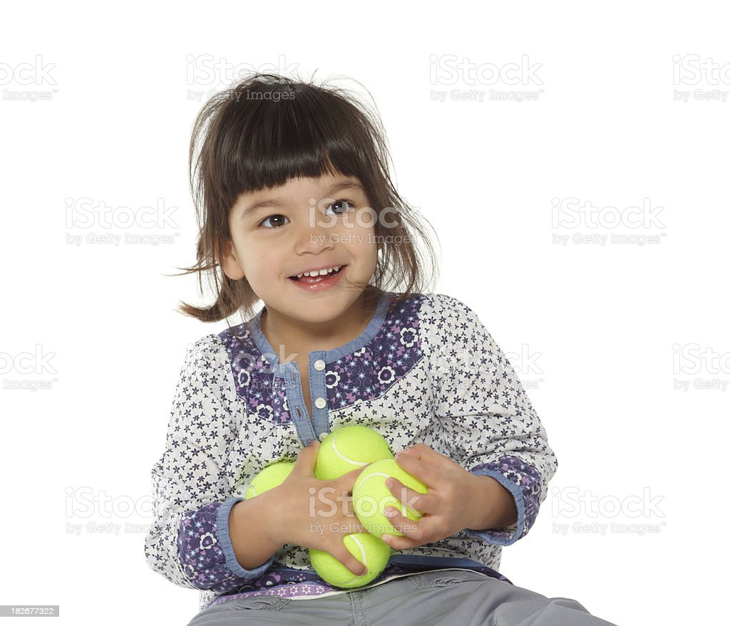 beautiful little girl playing with tennis ball royalty-free stock photo