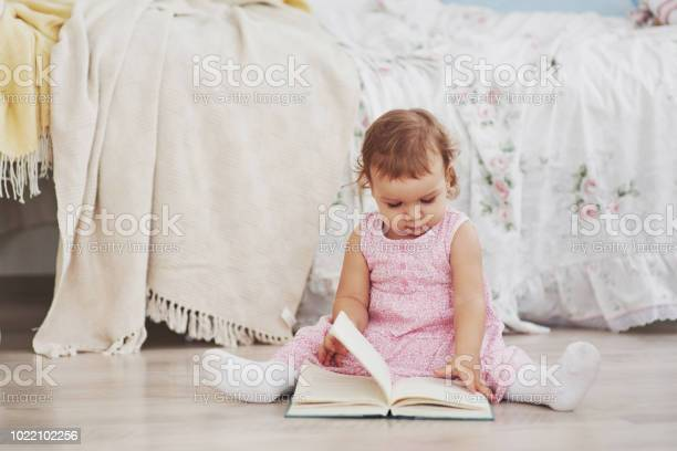 Beautiful little girl read book with her favorite bear on a soft picture id1022102256?b=1&k=6&m=1022102256&s=612x612&h=77cfyw6d64wrqboegmicwaiqepgq lv8jnkzt0oti30=