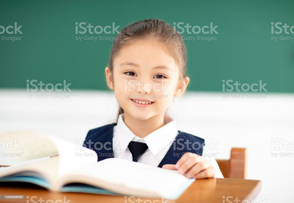 Beautiful little girl study in classroom stock photo & more pictures