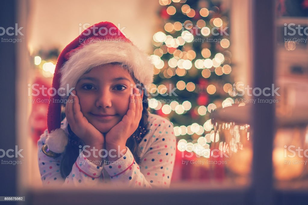 Beautiful Little Girl Waiting for Santa stock photo