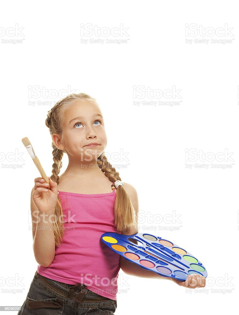 Beautiful little girl with a paintbrush, Isolated on white royalty-free stock photo