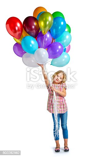 istock Beautiful little girl with balloons 502282562