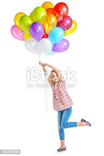 istock Beautiful little girl with balloons 502282594
