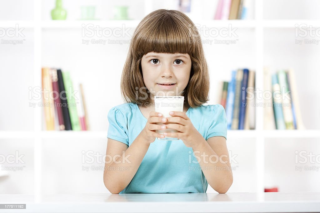 Beautiful little girl with glass of milk royalty-free stock photo