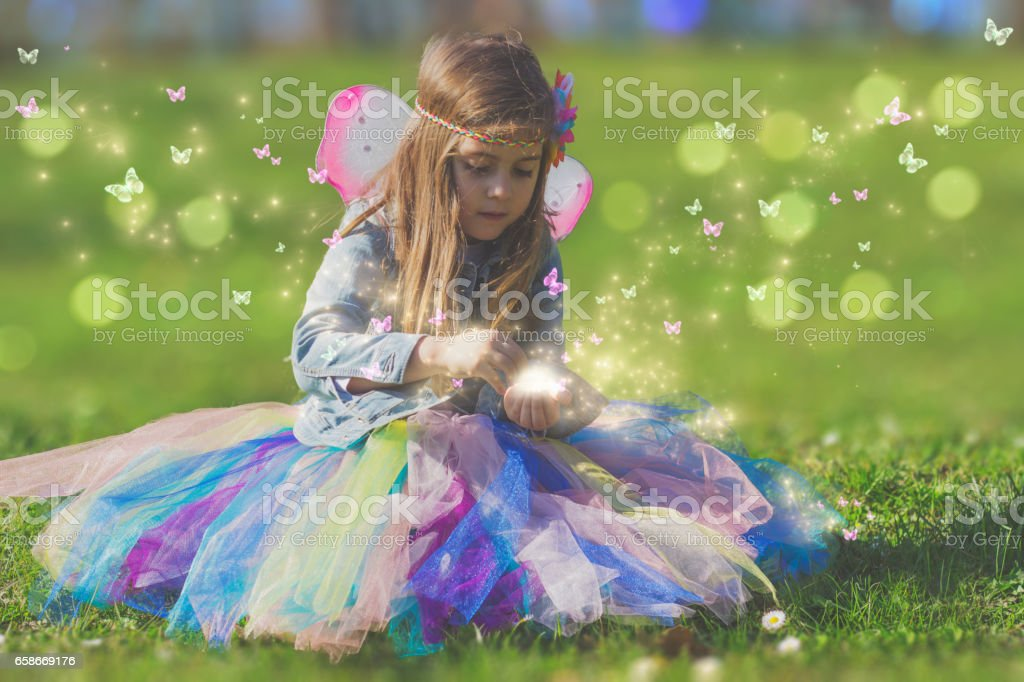 Beautiful little girl with magic butterfly; fantasy concept stock photo