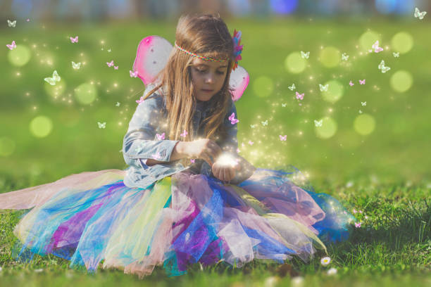 beautiful little girl with magic butterfly; fantasy concept - fairy wand stock photos and pictures