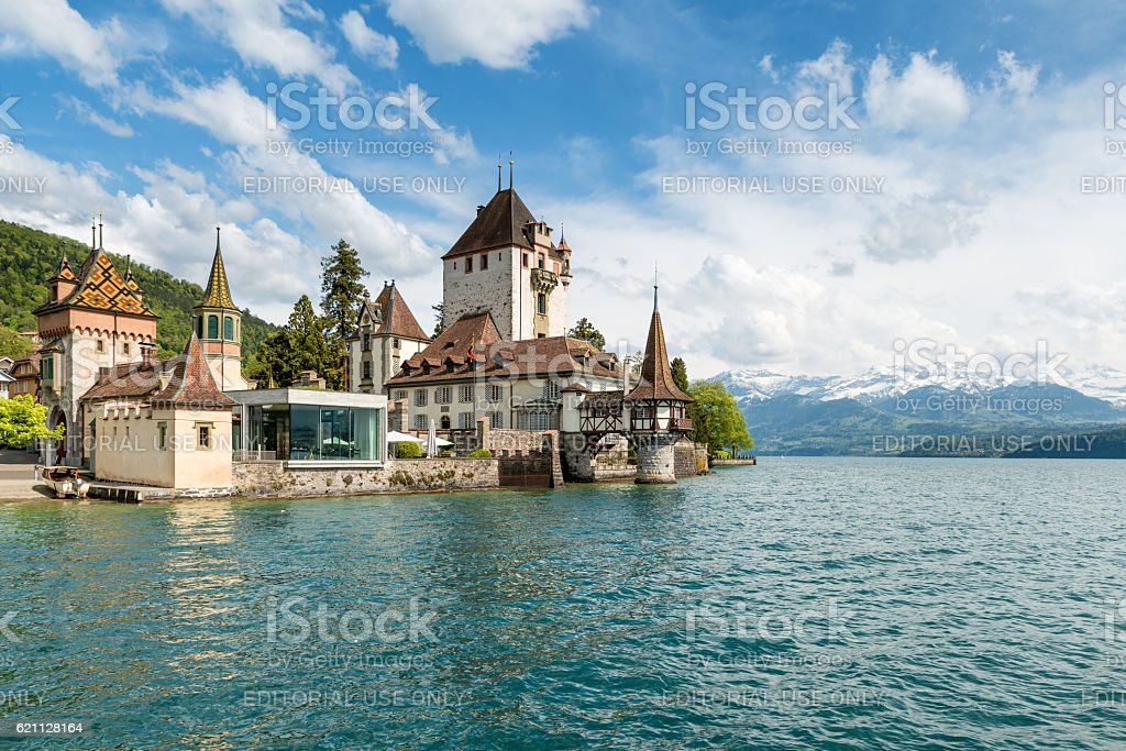 Beautiful little tower of Oberhofen castle in the Thun lake stock photo