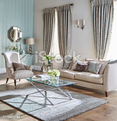 Home interior of cozy sofa with a armchair in a modern living room
