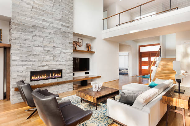 Beautiful living room interior with hardwood floors and fireplace in new luxury home stock photo