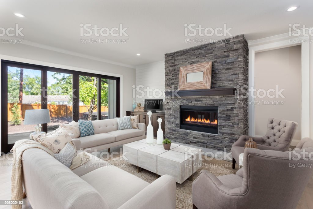 Beautiful Living Room Interior With Hardwood Floors And Fireplace In New  Luxury Home. Stock Photo