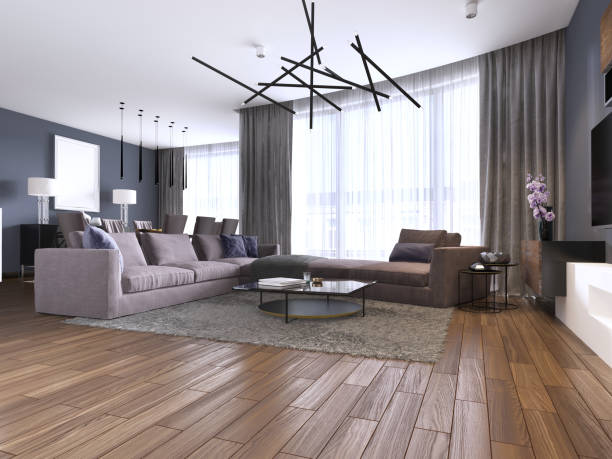 Beautiful living room interior with hardwood floors and large corner sofa violet color in new luxury home. Contemporary style.
