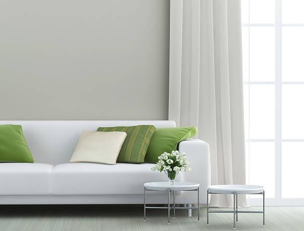schönes wohnzimmer - kissen grün stock-fotos und bilder