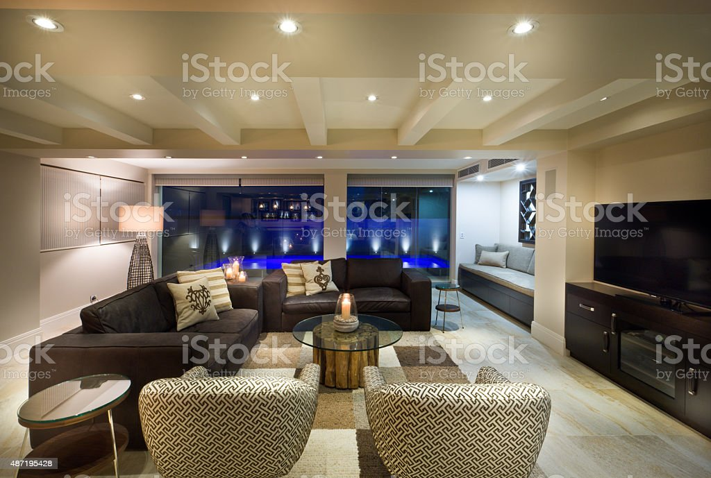 Beautiful living room with a tv set stock photo